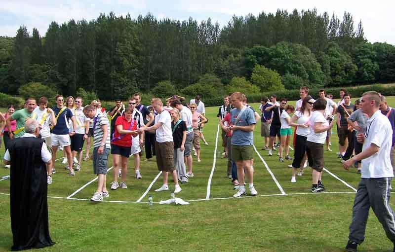 outdoor team olympics including sack egg spoon stilts wheelbarrow